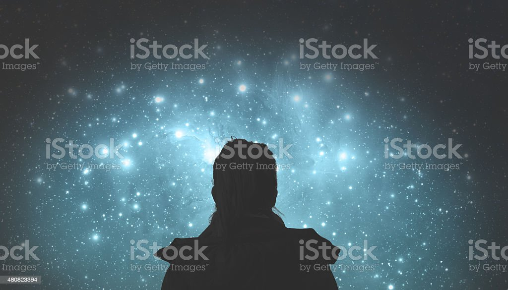 Girl watching the stars. Stars are digital illustration. stock photo