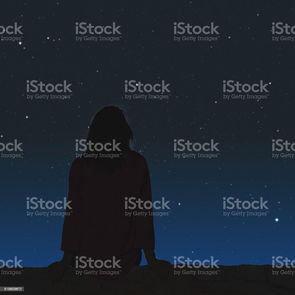 Girl watching the stars. Stars are digital illustration.