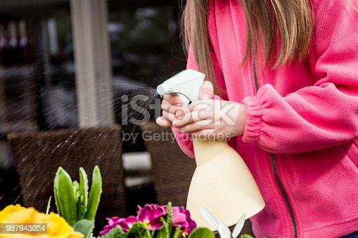 Girl Watering Planting Flower