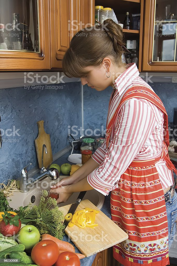 Girl watering vegetables royalty-free stock photo