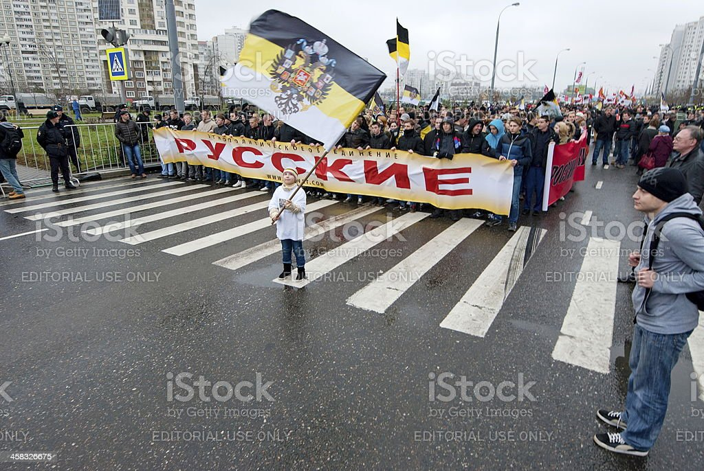 Girl waves flag during 'Russian March', Moscow, Russia. royalty-free stock photo