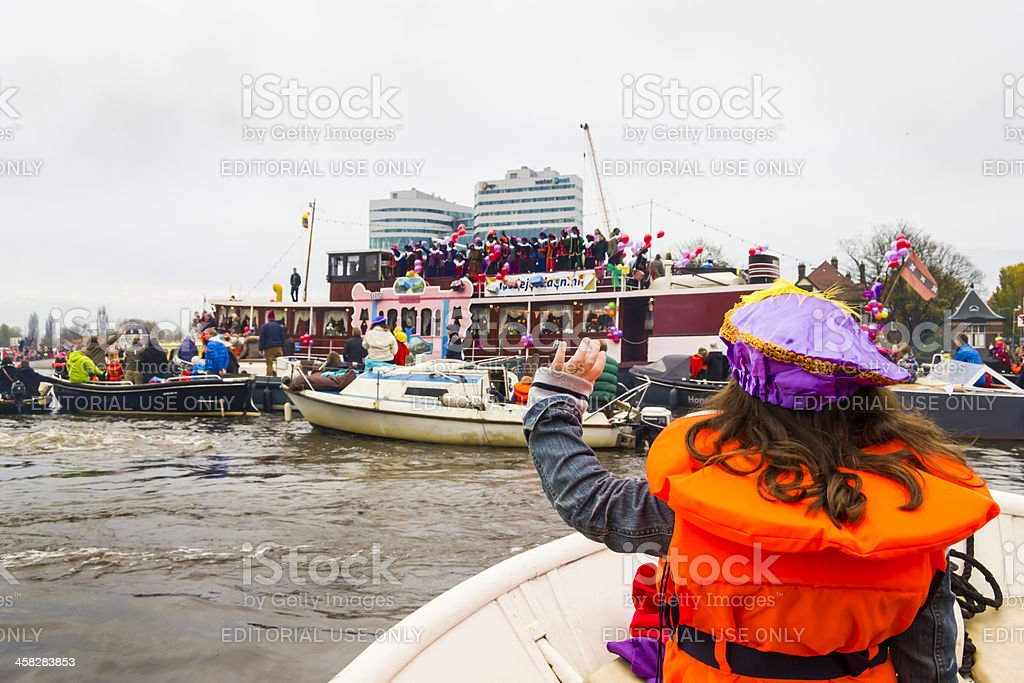 Amsterdam, Netherlands - November 18, 2012: Girl waves to Sinterklaas royalty-free stock photo