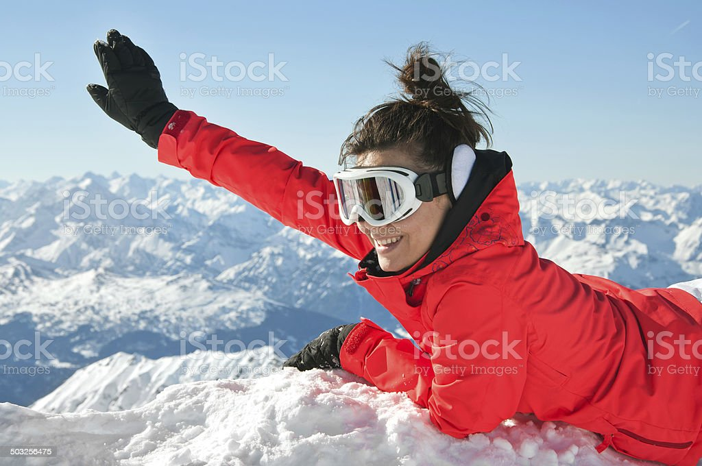 Girl waving and smiling from top of european Alps stock photo