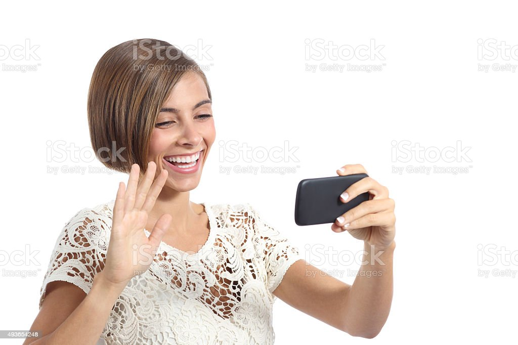 Girl waving on smart phone while during a video call stock photo