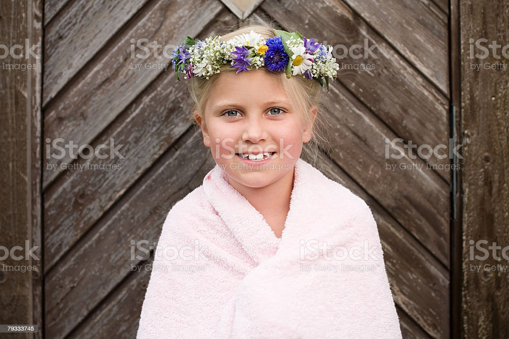 A girl wearing a garland of flowers 免版稅 stock photo
