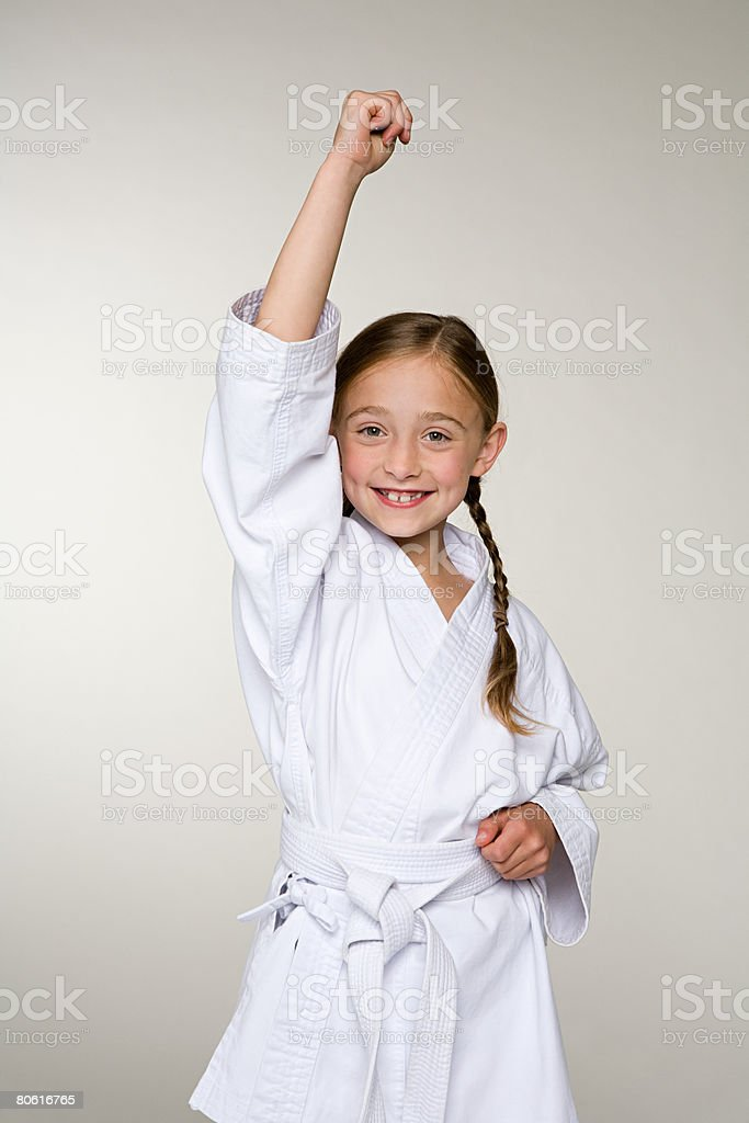 A girl wearing a karate uniform stock photo