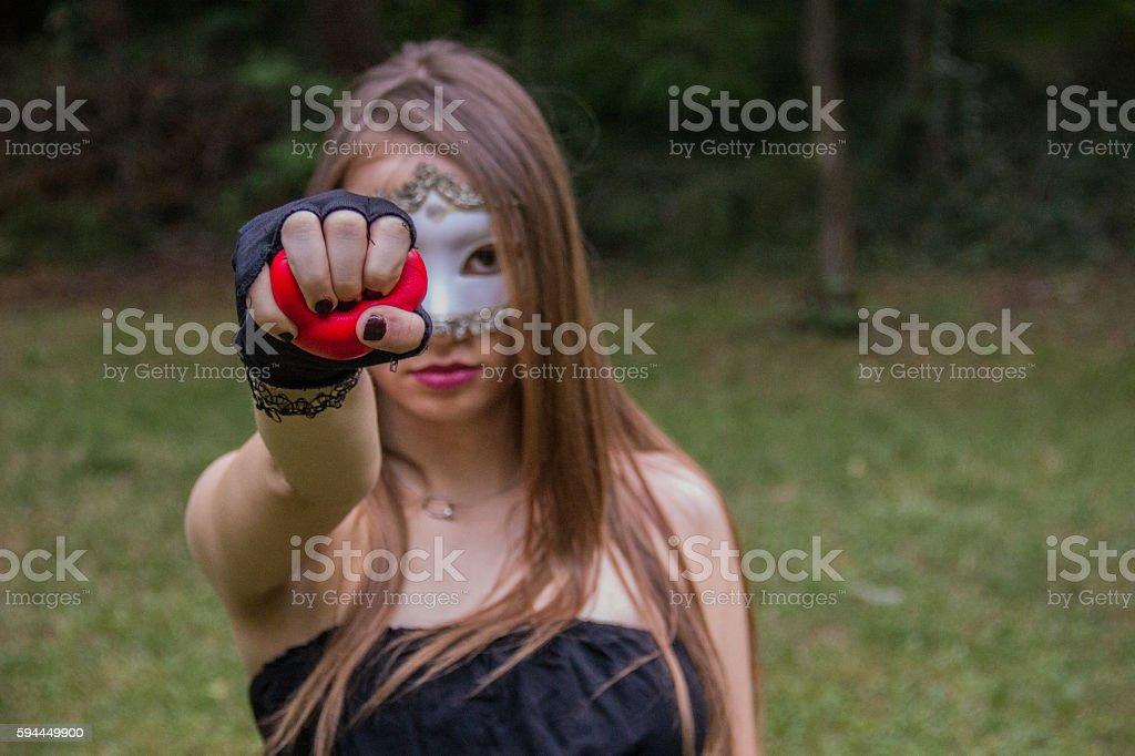 Girl wearing a mask stock photo