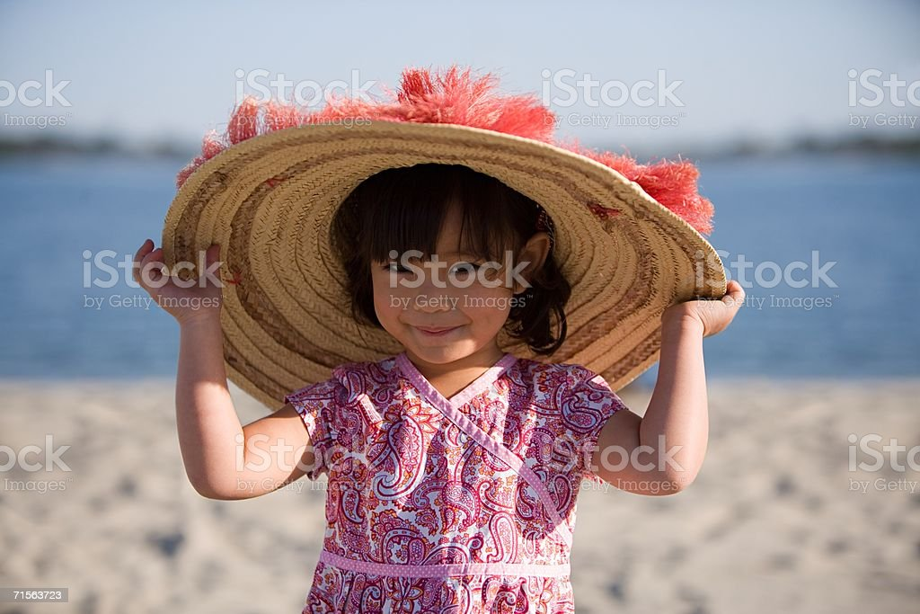 Girl wearing a sunhat stok fotoğrafı