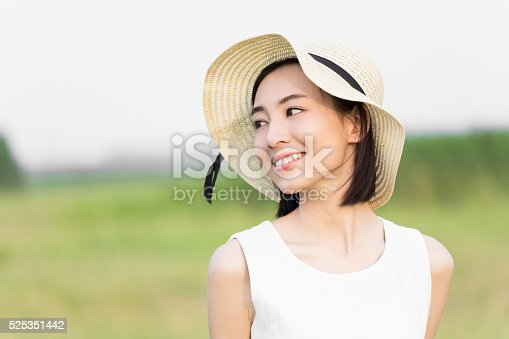istock girl wearing a white dress 525351442