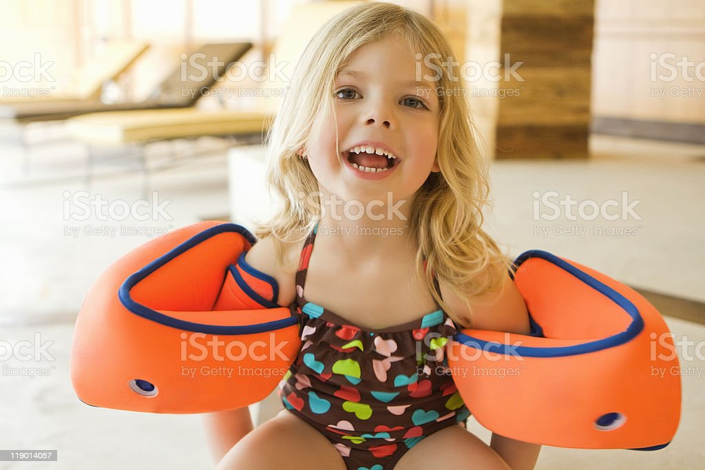 Girl wearing bathing suit and floaters stock photo