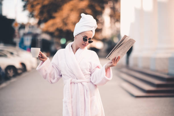 Girl wearing bathrobe stock photo