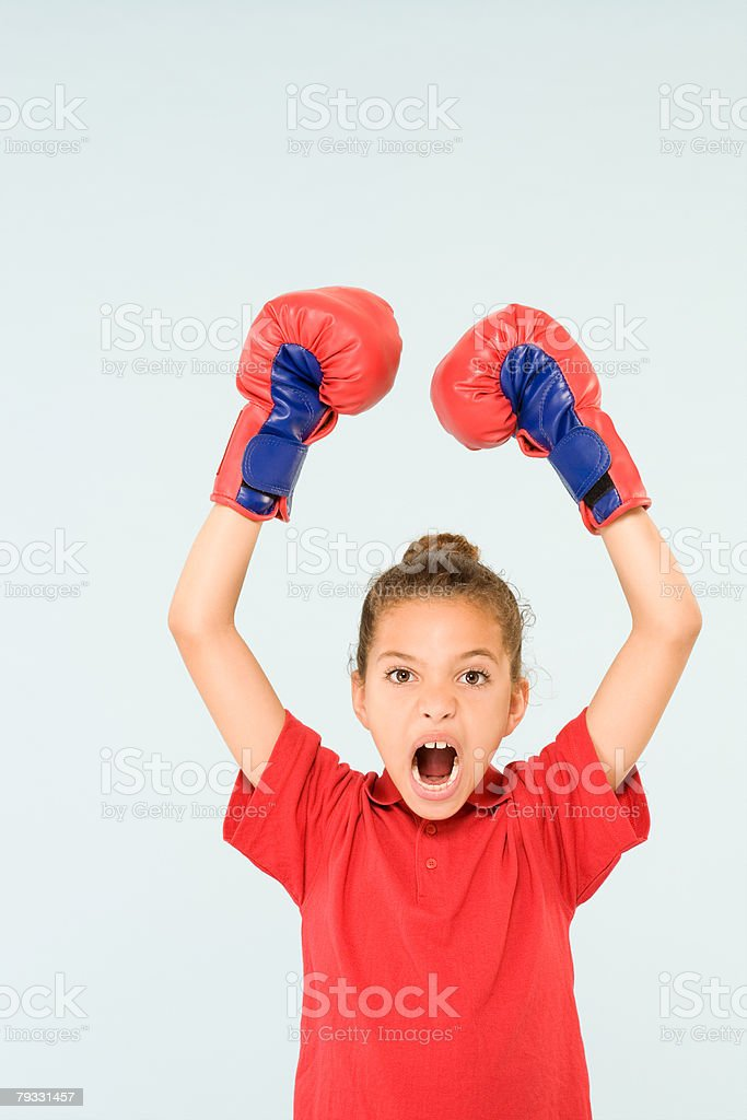Girl wearing boxing gloves royalty-free stock photo
