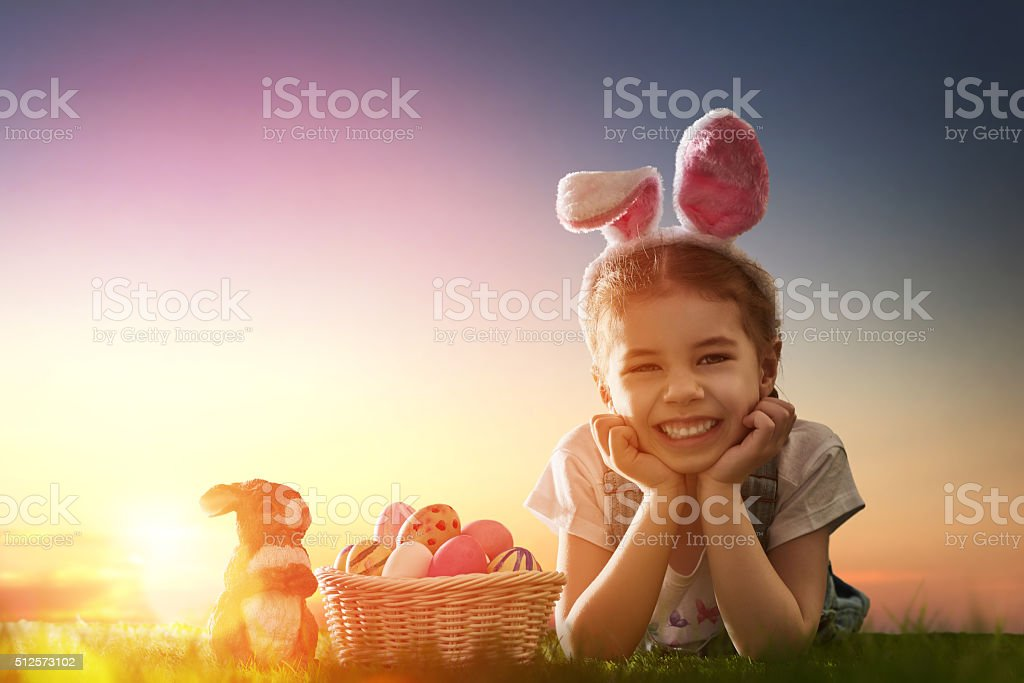 girl wearing bunny ears stock photo