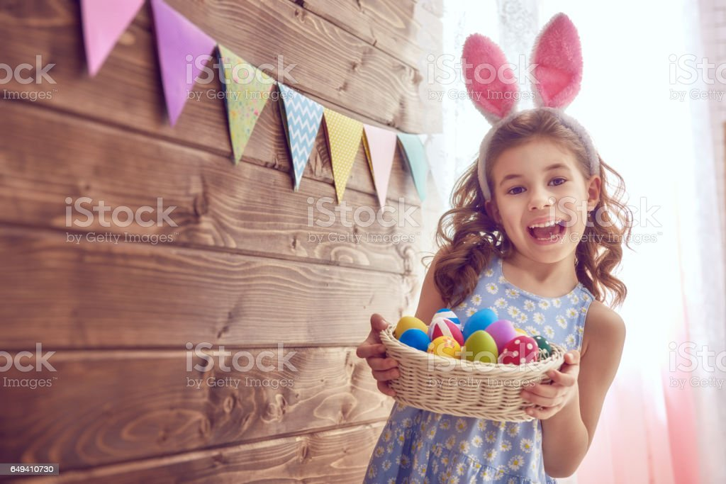 girl wearing bunny ears stock photo