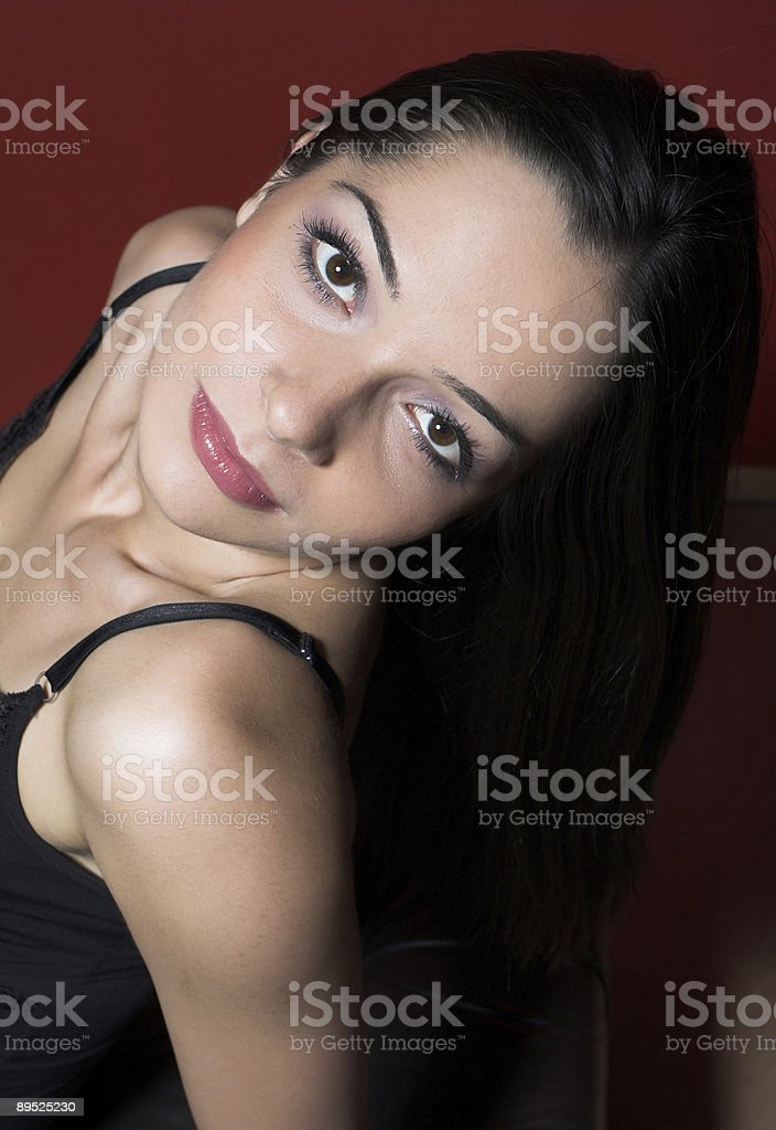 Girl wearing elegant clothes posing in the studio royalty-free stock photo