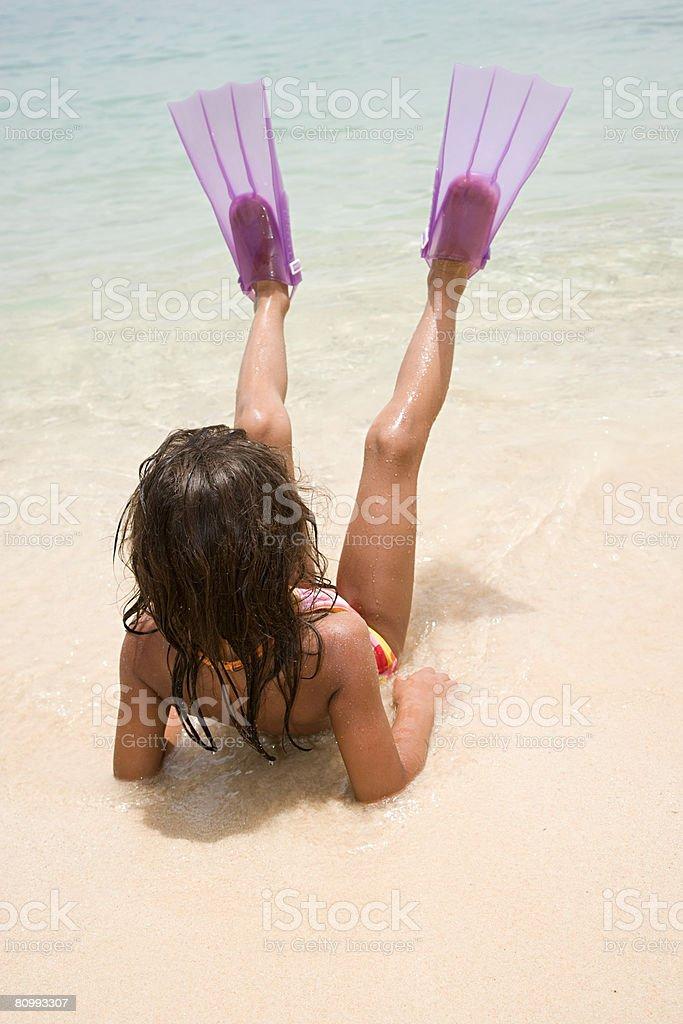 Girl wearing flippers 免版稅 stock photo