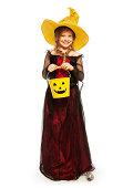 istock Girl wearing Halloween witch costume with bucket 513254847