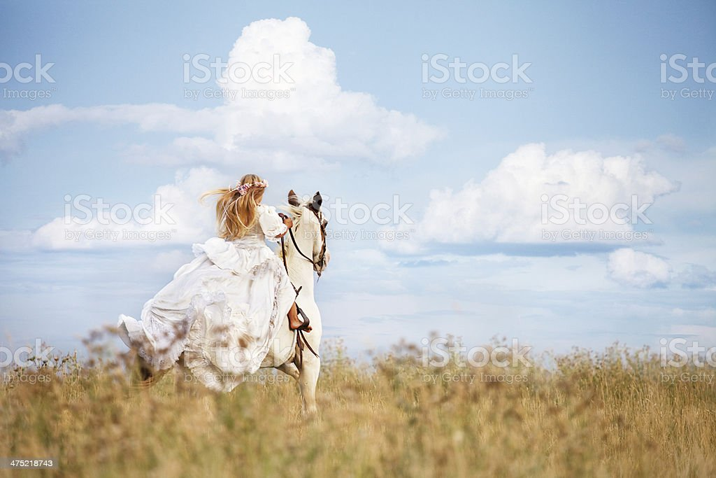 Girl Wearing Long White Dress Costume Riding Horse royalty-free stock photo