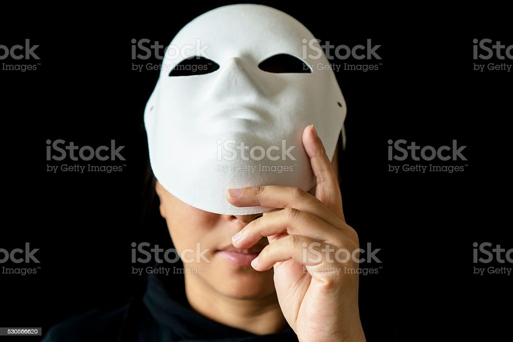 girl wearing mask in black backgrounds stock photo