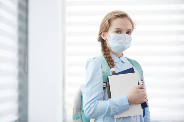 Girl Wearing Mask in School stock photo