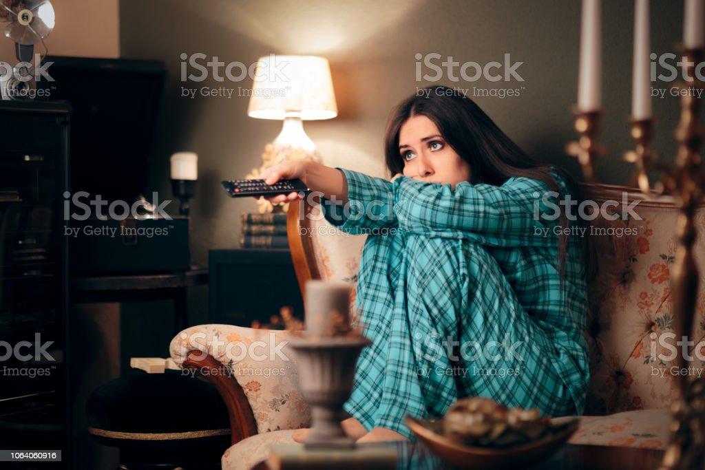 Girl Wearing Pajamas Watching TV in her Room stock photo