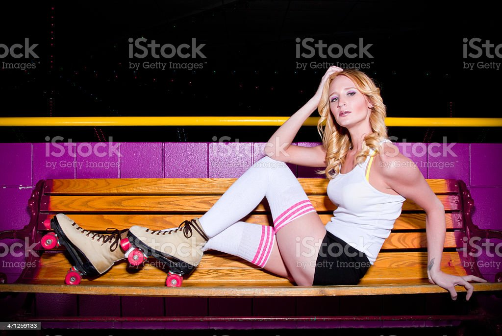 Girl Wearing Roller Skates On A Bench royalty-free stock photo