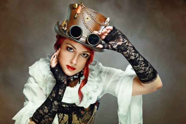 girl wearing steampunk hat - steampunk stock photos and pictures