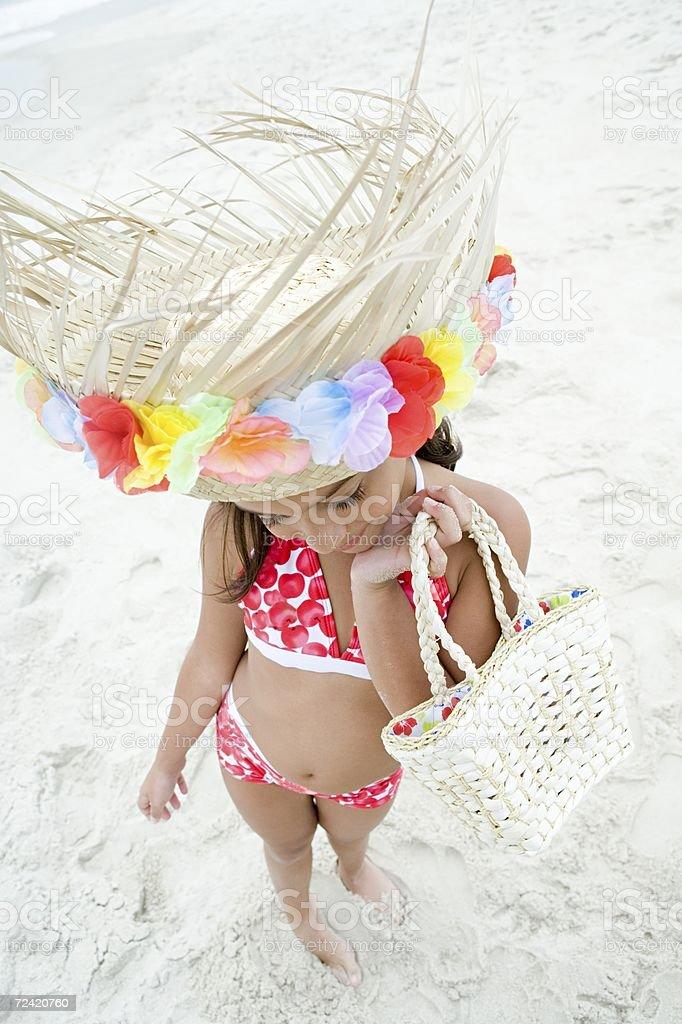 Girl wearing sun hat royalty-free stock photo