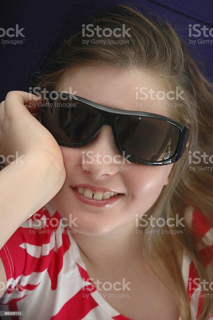 Girl wearing sunglasses royaltyfri bildbanksbilder