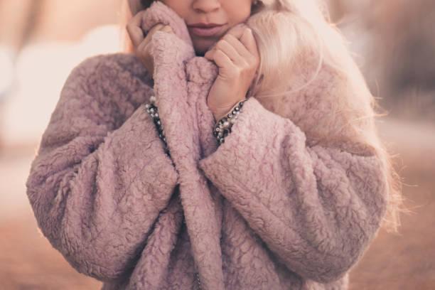 Girl wearing warm winter coat outdoors stock photo