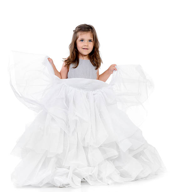 girl wearing white dress - petticoat stock pictures, royalty-free photos & images