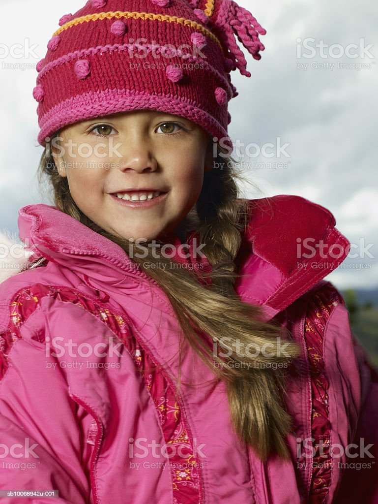 Girl (4-5) wearing winter clothing, outdoors, portrait royalty-free stock photo