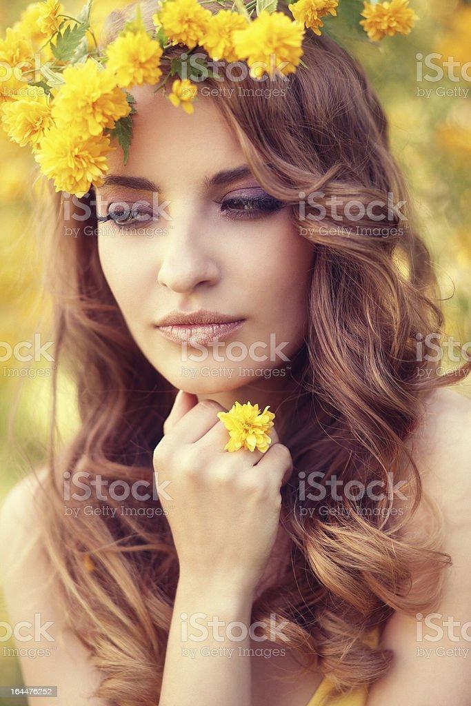girl wearing yellow flower wreath royalty-free stock photo