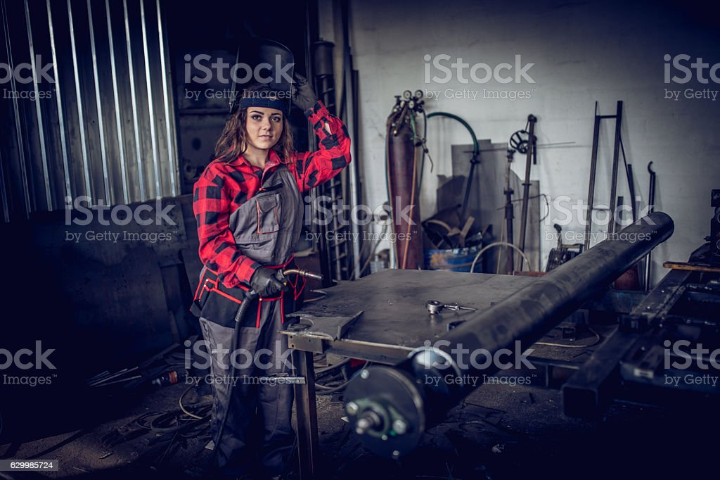 Girl welder in workshop stock photo