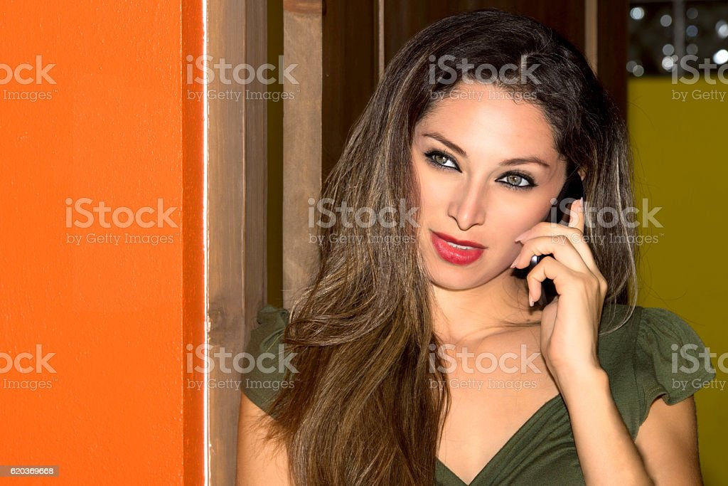 Girl while speaking at cellular smartphone foto de stock royalty-free