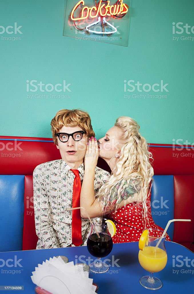 Girl whispering a secret stock photo