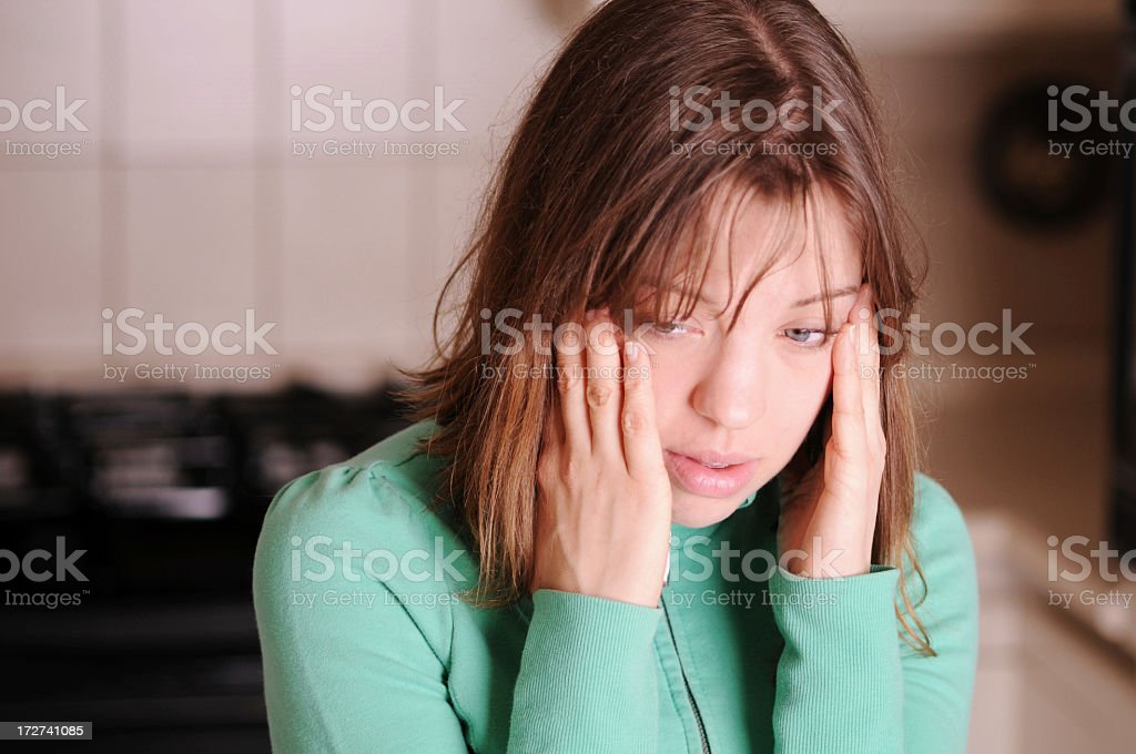 A girl who is clearly stressed and overwhelmed royalty-free stock photo
