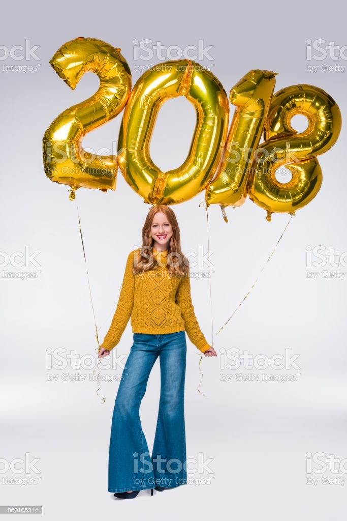 girl with 2018 balloons stock photo