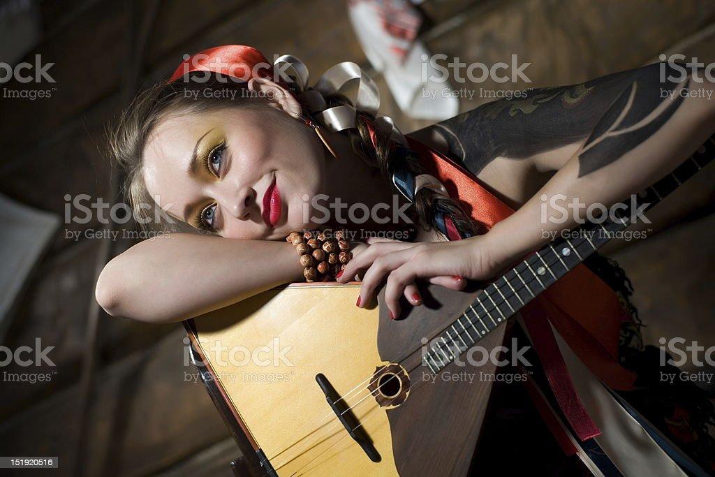 Girl with a balalaika stock photo