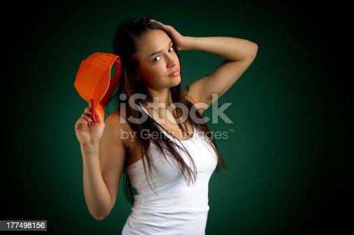 istock girl with a baseball cap 177498156