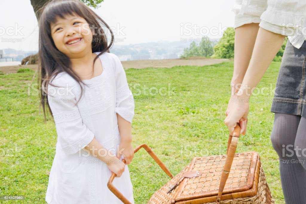 Girl with a basket with her mother stock photo