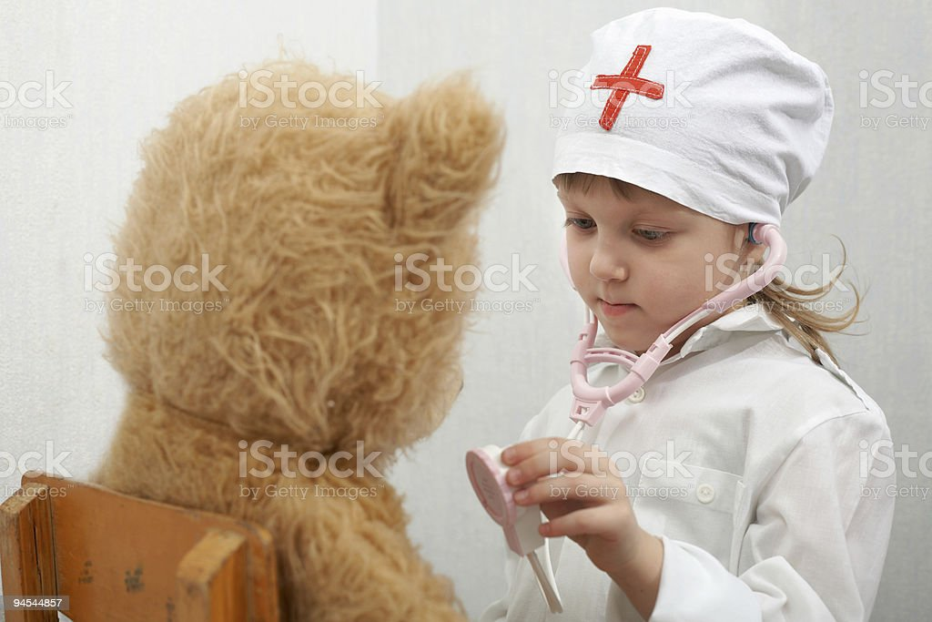 Girl with a bear royalty-free stock photo