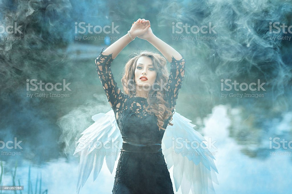 Girl with a beautiful face is to smoke. stock photo