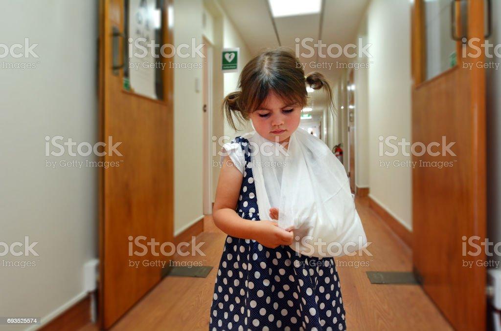 Girl with a broken arm stock photo