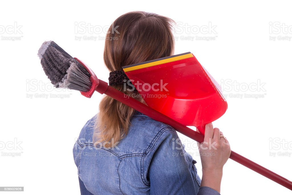 girl with a broom and dustpan for cleaning stock photo