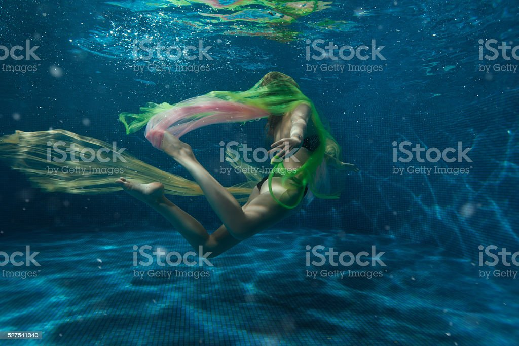 Girl with a cloth in the water. stock photo