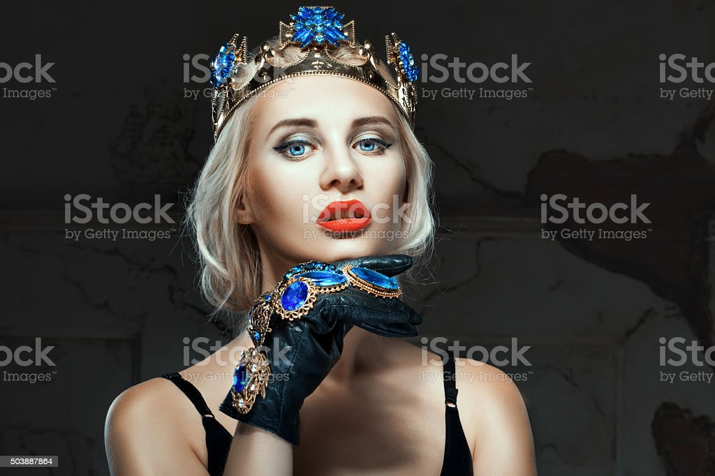 Girl with a crown on his head and blue eyes. stock photo