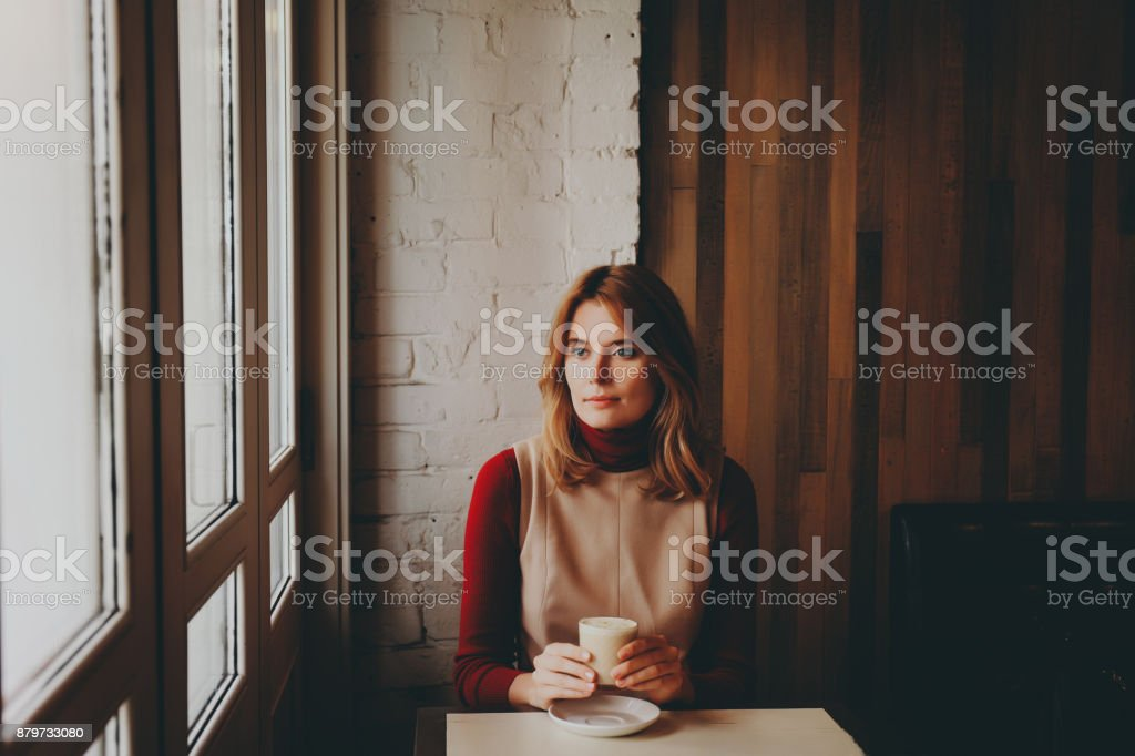Girl with a cup of coffee latte. stock photo