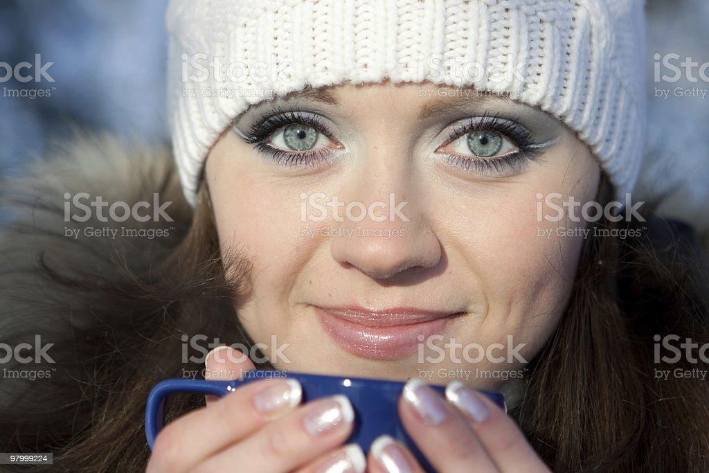 Girl with a cup of hot drink royalty-free stock photo