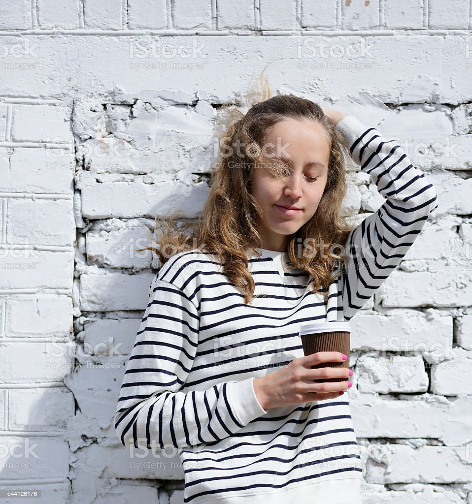 Girl with a disposable coffee cup stock photo